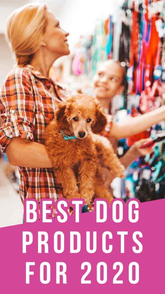Lady holding dog looks at dog products